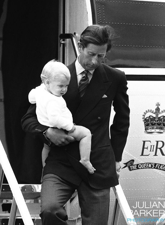 Prince Charles arrives at Aberdeen Airport, carrying Prince William from The Queens Flight, on their way to Balmoral Estate with the Princess of Wales