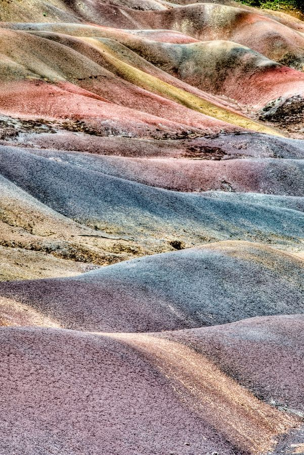 Chamarel or Coloured earths this natural phenomenon is due to decomposed basalt gullies. The hot and humid climates helps in the decomposition of the basalt into clay.