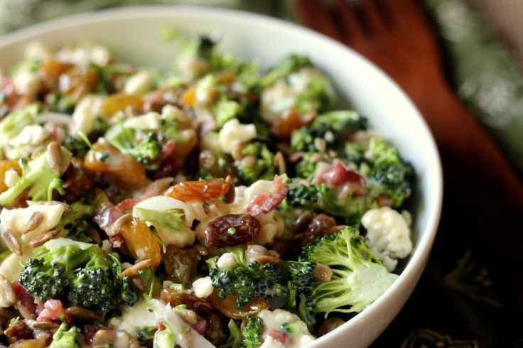Delicious cauliflower, broccoli, sunflower seeds, bacon and raisins in a sweet and tangy dressing. Cauliflower brocolli salad at it's best!..