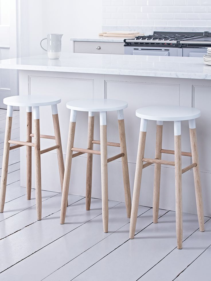 Carefully handcrafted from sustainable and responsible raw oak, our contemporary round topped stool features visible wood grain details making each stool completely unique. Each has a soft white top to compliment the natural wood. Suitable for seating around a breakfast bar or as a standalone seat, this stylish stool features gently angled rounded legs and four decorative rungs. Also available in natural.
