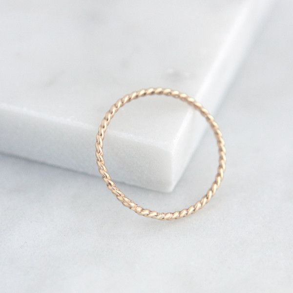 This beautiful band ring is available in 14k gold-filled or sterling silver. Its twisted texture adds a touch of elegance to your look. Wear alone, or layer with other rings from our collection. - Cho