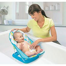 """I didn't use a big clunky plastic bath tub. I used this little bath sling. It's small, can be used in the kitchen sink and easy to dry. $16.99  Summer Infant Mother's Touch Baby Bather - Summer Infant - Babies """"R"""" Us"""