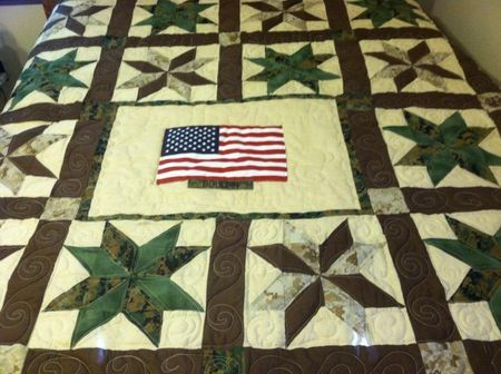 Quilt made with military uniforms after service member got out. I should totally do this with mine and Terry's uniforms!