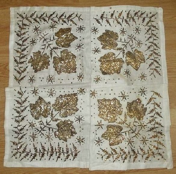 'Çevre' (square kerchief; a decorative accessory for interiors, but also often used in festive / parade men's costumes). 1900-1950. Embroidered with the 'tel kırma' technique (geometrical motives obtained by sticking narrow metallic strips - often silver - through the fabric and folding them. The motifs are identical on both sides of the fabric).