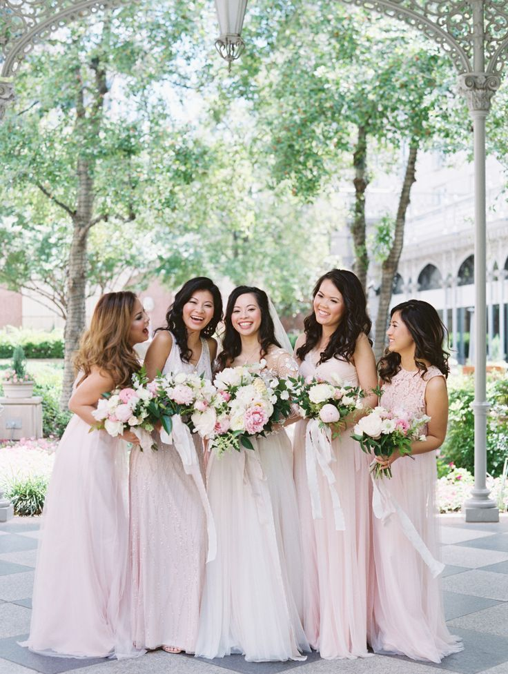Long blush bridesmaids' gowns | Photography: Stephanie Brazzle
