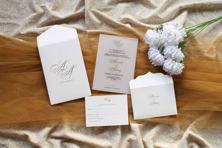 vinas invitation. sydney wedding invitation. indonesia wedding invitation. simple white. wedding invitation. pure white. simple white. white acrylic . any question please visit website www.vinasinvitation.com . courtesy of Alesandra & Anthony