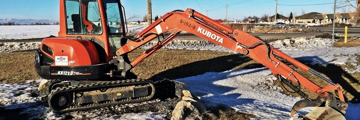 Kubota Excavator in the Snow