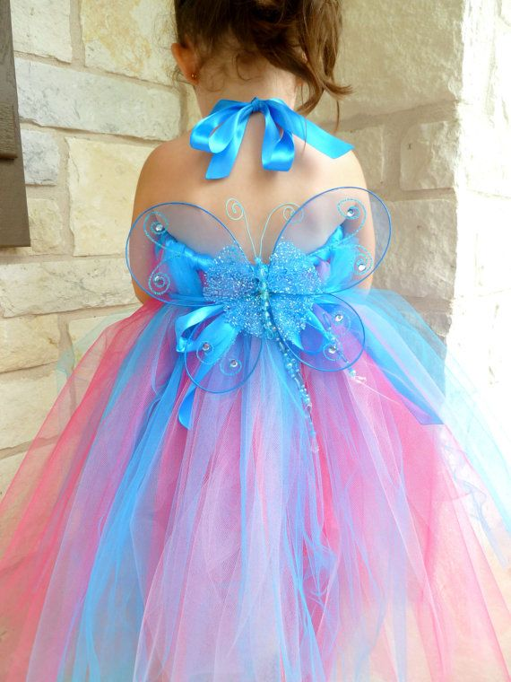 Beautiful Handmade Fairy Princess Tutu dress with Fairy Wings. Fairy Princess Tutu Dress is made of Turquoise, Pink, and Hot Pink nylon tulle.  Top