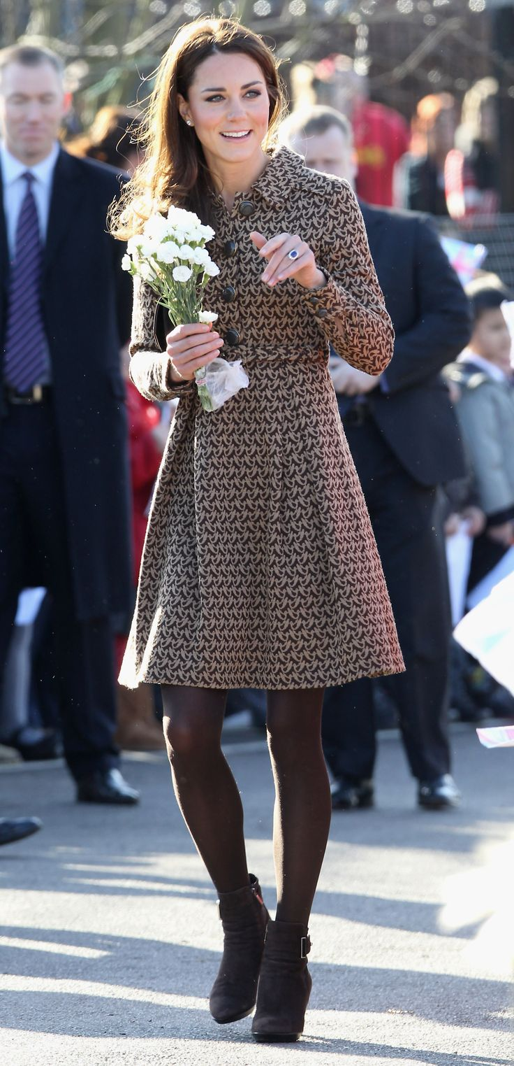 Kate in a splashy dress paired with brown tights