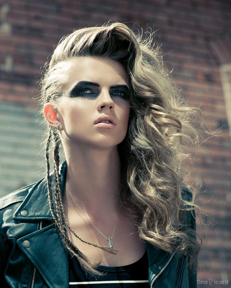 Ash blonde hair in a slightly whipped parted long hairstyle with a mix of thin b…