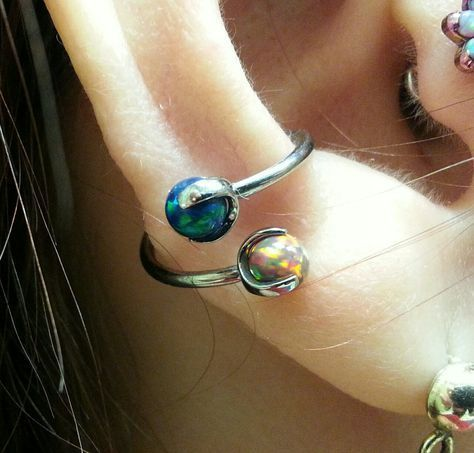 I just had the pleasure of switching the jewelry in Carol's well healed conch piercing to a twister with black and fire opals from Industrial Strength. Kristy Baird Sacred...
