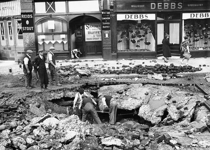 A huge crater was made in a road at Elephant & Castle, London on September 7, 1940, after a night raid on London . (AP Photo/Staff/Worth)