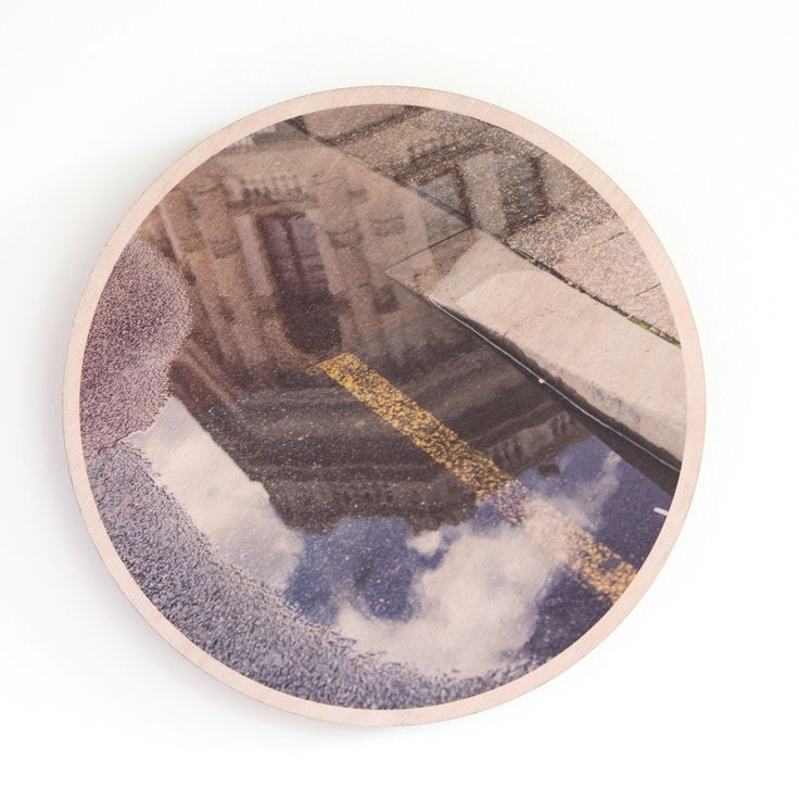 Jo Ward Photography Fre Reflections A wet afternoon wandering around Fremantle resulted in some great puddle reflections of the beautiful architecture.  Taken on the corner of High Street and Pakenham Street, Fremantle, Western Australia 290 mm diameter image printed directly onto  marine grade plywood using UV print technology.  Comes complete