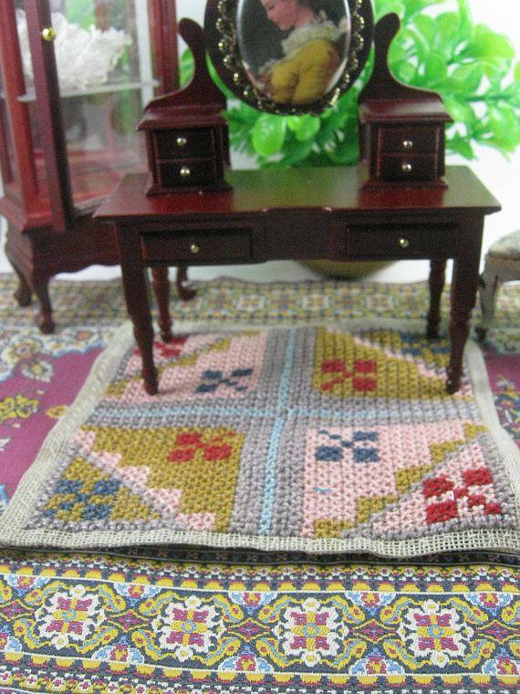 Cross-stitched rug