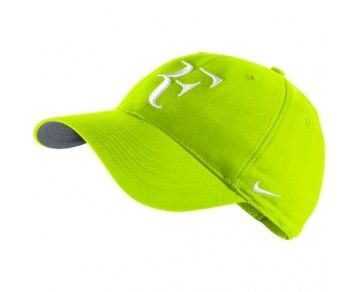 Nike RF Roger Federer Unisex Tennis Hat/Cap Volt Yellow:   Nike offers Roger Federer's RF cap in the latest color way. Features Dri-FIT 58% cotton/42% polyester fabrication to keep you cool and adds function to the fashion. Dri-FIT sweatband inside cap and adjustable velcro closure at rear. 3-D embroidered RF logo at front and embroidered Nike Swoosh at left of cap. Embroidered Federer at center back.ulliColor: Volt/Flint Grey/White/li /ulMidwest Sports only ships Nike products to dome...