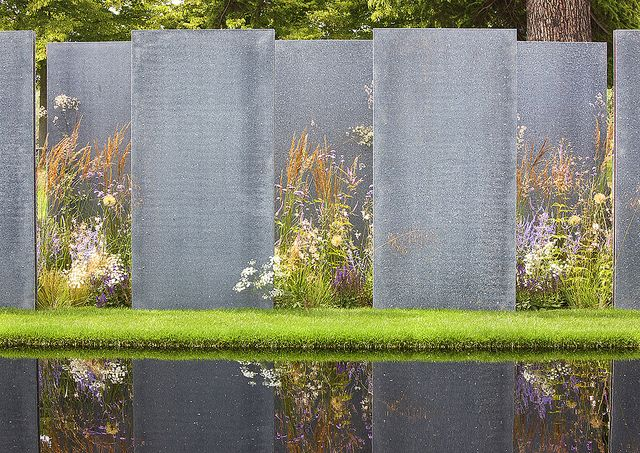 Not designed as sculpture ~ Never-the-less these offset metal panels make a beautiful garden installation.