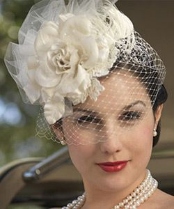 Find Couture Bridal Veils, Bird-Cage Veils and fasinators from Laura Jayne Bridal Designs. Beautiful veils, hats & flower fasinators. to complete your wedding day look.