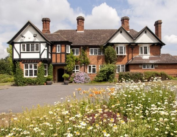 Yew Lodge House - Main house in Summer Yew Lodge Country House wedding venue in East Grinstead, On the borders of Kent, Surrey & West, Sussex