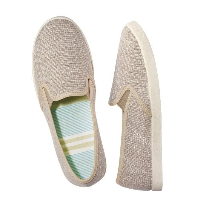 Slip-On Canvas Sneaker Slide. A beautiful jute canvas with metallic thread for subtle spark, yet a trendy shoe to complete any look this spring!    FEATURES  • Jute canvas with metallic thread for subtle sparkle  • Thin light blue and white striped fabric lining, with a few thicker natural stripes  • Natural colored outsole  • Whole sizes: 6M -10M  • Run true-to-size  • Bottom of the soles are skid-resistant    MATERIALS  Upper: Canvas, Elastic  Sock: Fabric and foam  Outsole: TPR (T