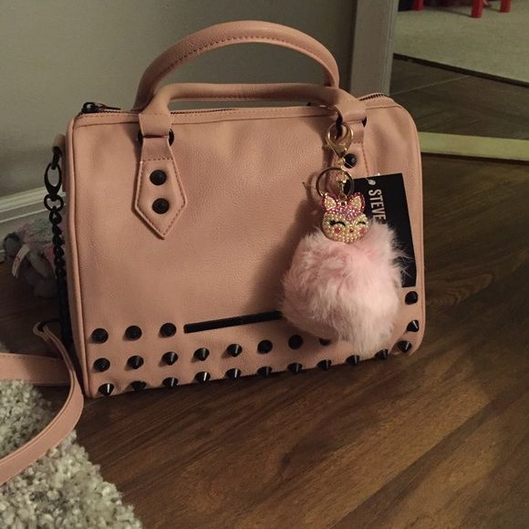 """SALE Steve Madden Studded Satchel⭐️ ⭐️NWT⭐️ Steve Madden """"Balexa 2"""" Studded Satchel ❤️ Color is blush❤️ Studs are black❣ Long strap included This bag is awesome  Pom not included if you would like to purchase I can add $15 to the listing so please let me know beforehand. Steve Madden Bags Satchels"""