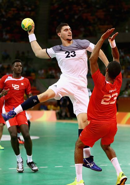 Ludovic Fabregas of France shoots under pressure from Oussama Hosni of Tunisia during the Mens Preliminary Group A match between…