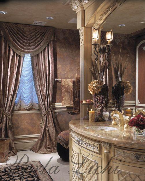 Sweet powder room with custom carved vanity.