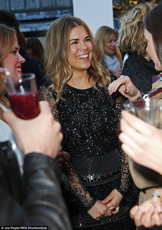 Writer and chef @madeleine_shaw_ wears the black lattice lace feather and sequin dress by Matthew Williamson to the launch of her book at Harvey Nichols, London.