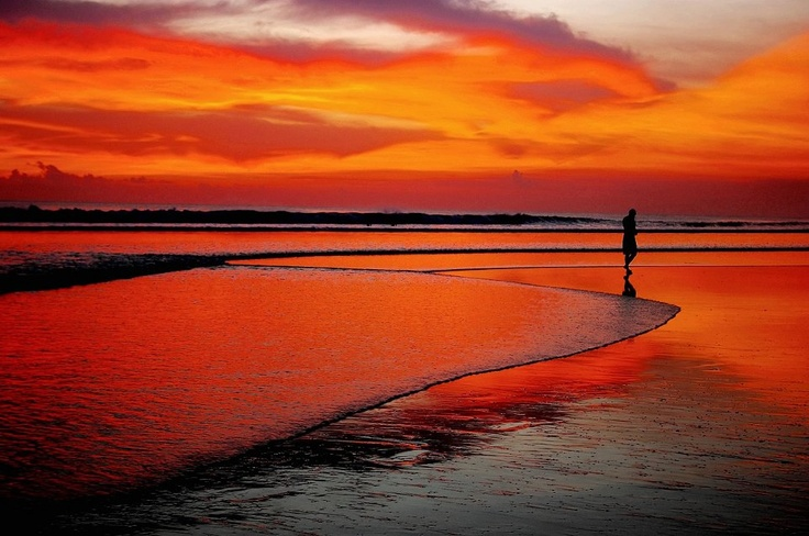 Tropics Magazine l Red sunset at Seminyak, Bali, Indonesia.   Photographer unknown
