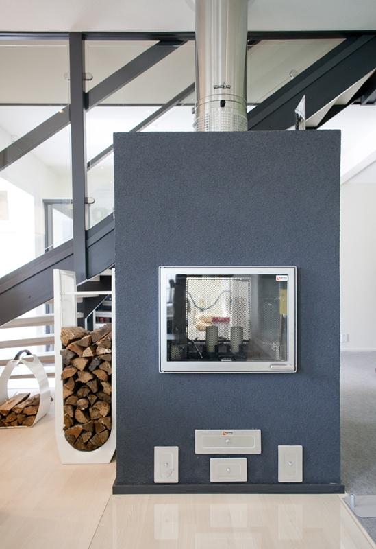 Takka | Asuntomessut Double sided ceramic heat store wood stove.