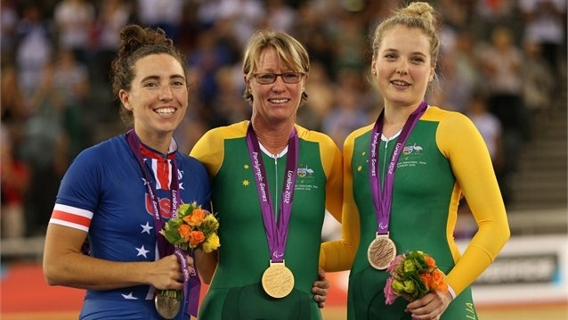 Silver medalist Megan Fisher of the United States, gold medalist Susan Powell of Australia and bronze medalist Alexandra Green of Australia pose on the podium during the medal ceremony for the women's Individual C4 Pursuit Cycling on Day 1 of the London 2012 Paralympic Games at the Velodrome