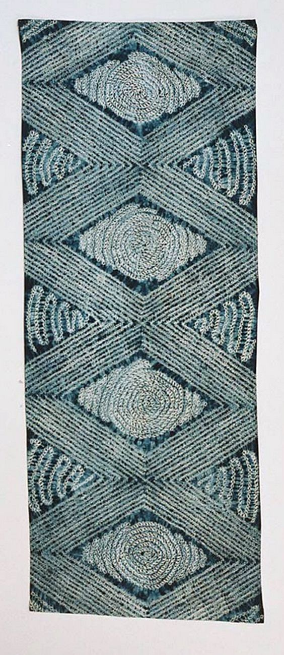 Africa | Adire alabere and oniko, 1975-86 | Indigo dye with gathered, hand-stitched and tied resist on cotton (unseamed)