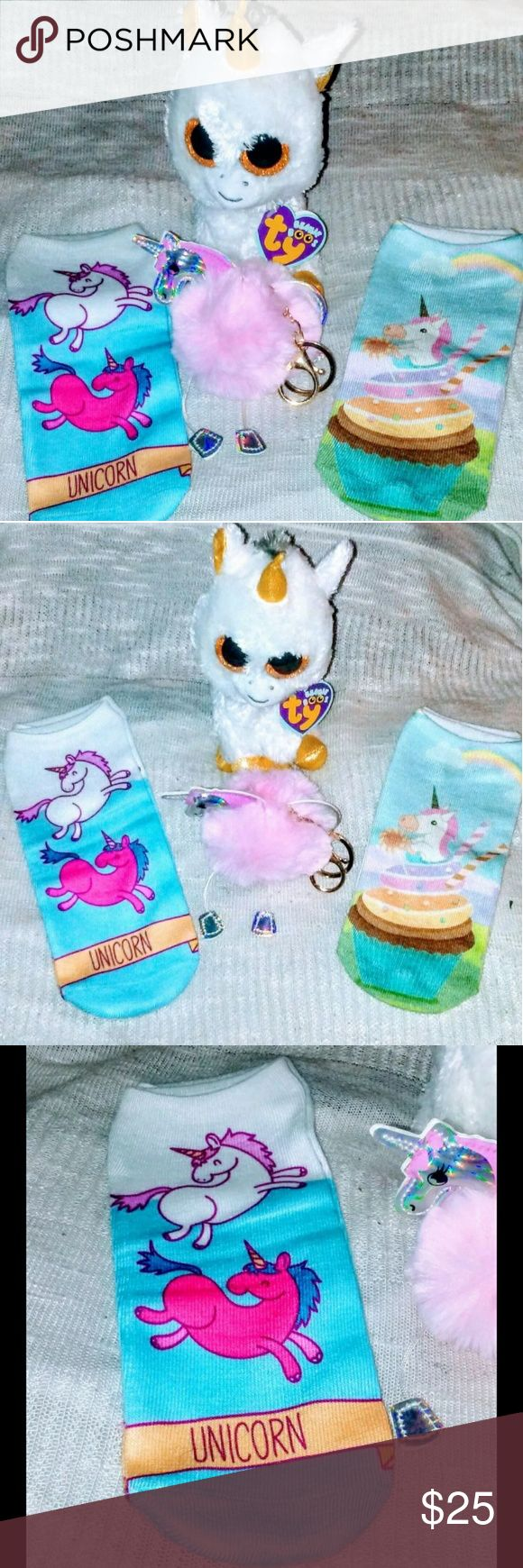 Unicorn Bundle All brand new, with tags....this cute bundle is for the mystical side of you. It includes 2 pairs of adorable sox, an unicorn, puff ball, purse/keychain & an unicorn Beanie Boo(limited edition)....who wouldn't want this fairy tale set, added to their collection? perfectreds closet Other
