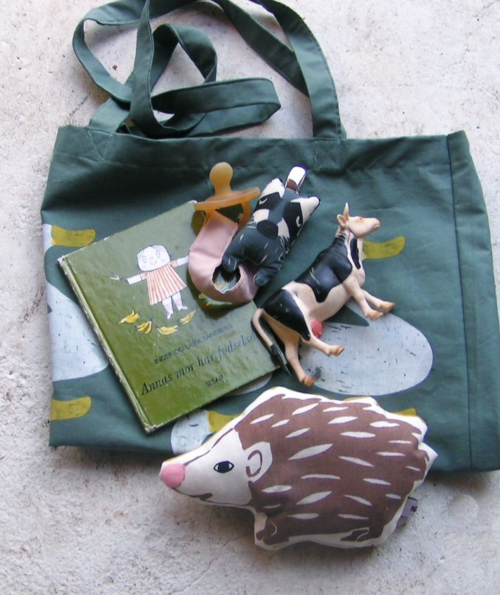 The silk screened hedgehog baby rattle in new soft color Pacifier holder Raccoon and tote pretty swan www.normadot.com #normadot #newbabygift #danishdesigner #dansk #babyshowergift #babyrattles #babygifts #wholesalebaby #hedgehog #silkscreendesign #babyrangle
