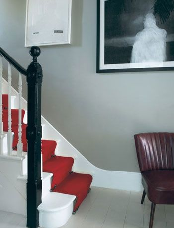 Try different shades of white  Break up a graphic monochrome hallway with a hot red stair carpet. Use different shades of white paint for the floorboards, skirting and stairs to create an interest point of contrast.