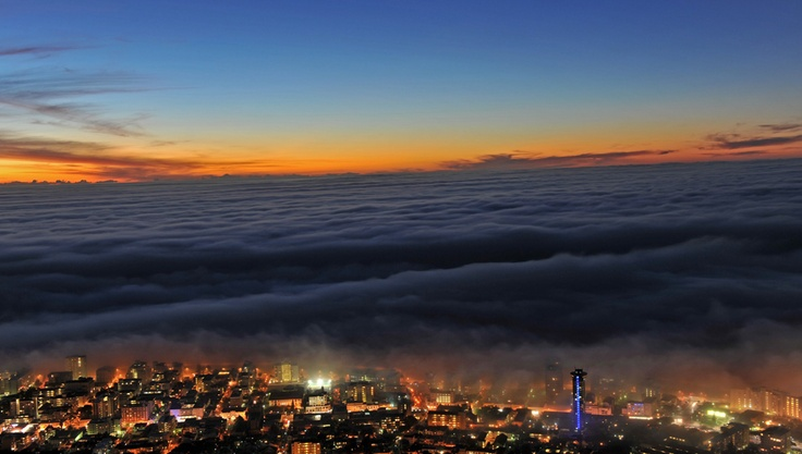 Cape Town sunset  As the Southern Hemisphere descends into winter, wafts of mist float above the Atlantic Ocean at sunset in Cape Town, South Africa on May 17.