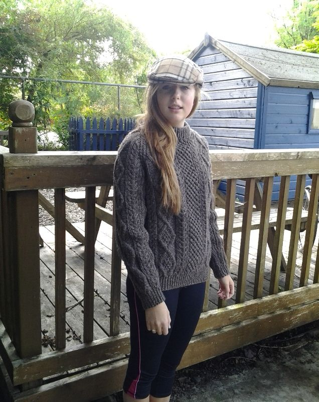 Handknitted in South West Donegal for Irish Handcrafts. Highest quality craftsmanship. Suitable for men and women this Irish Fisherman Sweater features classic Aran knitting patterns.