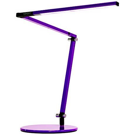 Add a burst of color to your work space with this modern LED desk lamp featuring purple finish aluminum construction and one touch dimming and on/off controls.