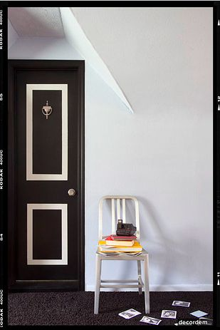 Transform a plain door with paint and masking tape.   42 Ingeniously Easy Ways To Hide The Ugly Stuff In Your Home