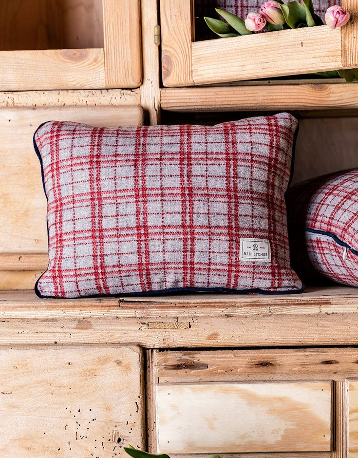 Gramercy Wool Pillow case is crafted in a plaid and finished with navy blue trim. It comes with a fluffy and springy pillow insert.
