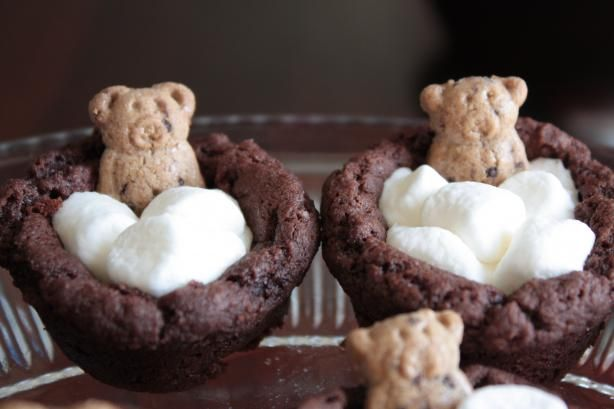 teddies taking bubble baths!!!!!!<3 brownies made in a cupcake pan....remove from tin....cover the tops with mini marshmallows and stick a teddy cracker, toes first, into the *bubbles*.......click through for the award winning recipe.... :-)