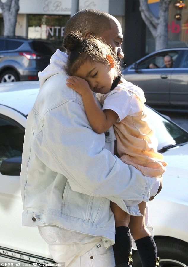 Exhausted: The two-year-old took a quick nap on her father's shoulder during a shopping trip in West Hollywood
