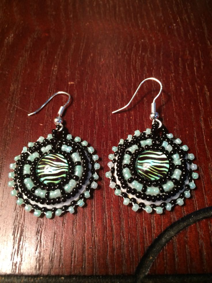 Mint and black zebra beaded earrings.