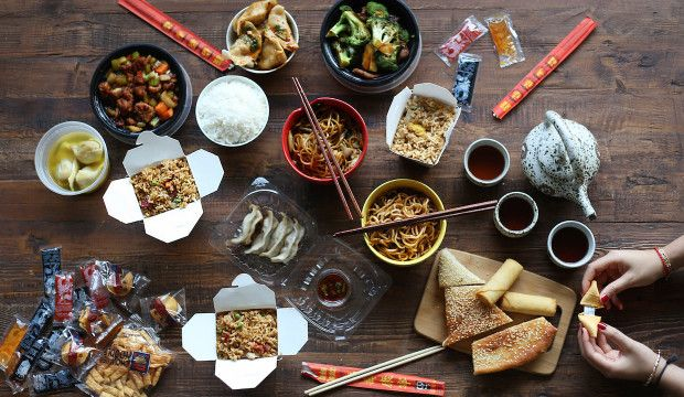 chinese-takeaway-spread-with-hands-fortune-cookie copy