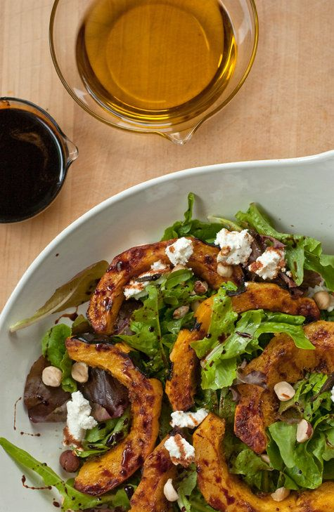 Roasted Squash over Arugula with Goat Cheese and Hazelnuts.