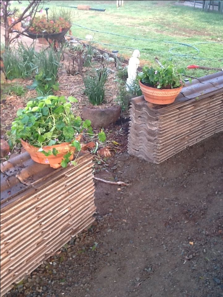 We created our garden walls from some of our roof tiles after replacing the roof with colour bond.