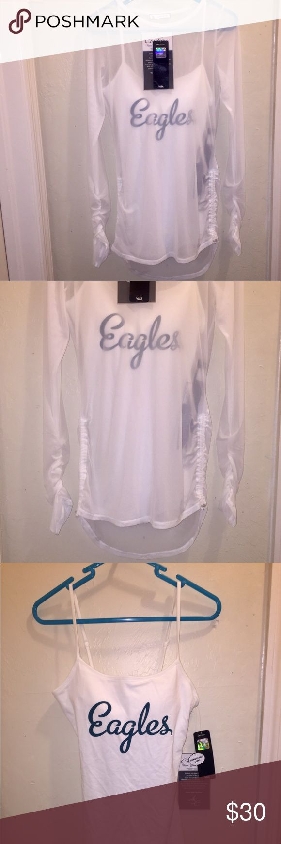 "NFL Philadelphia Eagles Double Team Tank/Shirt NWT This white sheer mesh tunic looks fabulous wherever you go! The sleeves have 6"" of ruching & the side seams have 8"" of ruching that allow adjustments that create the length that is just right for you. Underneath is a stretch knit, body fitting cami with a built in shelf bra with removable pads & adjustable straps. The cami hits mid hip with a generous bottom opening to stay down. The front chest has Eagles in a fun script & just above the…"