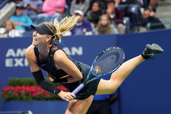 Russia's Maria Sharapova serves the ball against Sofia Kenin of the US during their 2017 US Open Women's Singles match at the USTA Billie Jean King National Tennis Center in New York on September 1, 2017. / AFP PHOTO / Don EMMERT - 857 of 962
