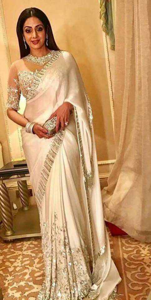 Sideview in a white saree