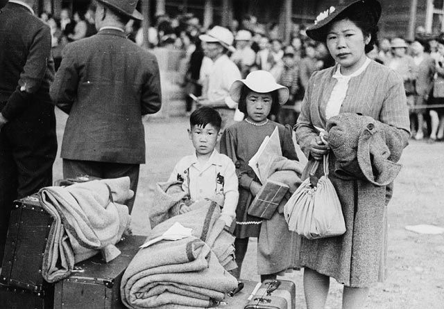 Japanese Internment-Family waiting to be relocated---Archives Canada, government website therefore reliable---Many Japanese-Canadians were taken from their homes without any reason except that their ancestors were Japanese. This shows the hostility and racism in Canada a the time. Internment camps were compared to Nazi Concentration Camps and many families were separated.