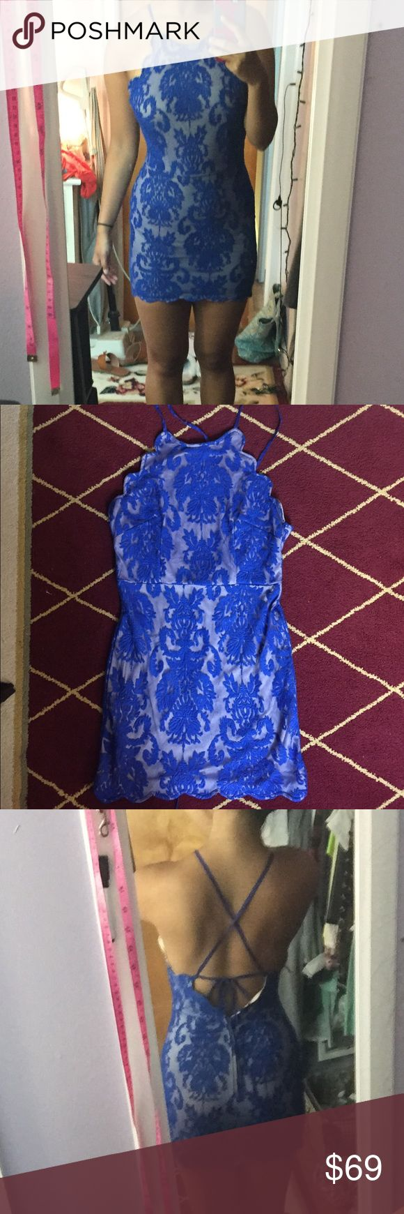 """Blue lace open back dress Brand new never worn. Fits like a USA small/medium. Brand is Hello Molly. Australian size 12 (a US size 8). I am 5'6 & 150 pounds 28"""" waist and it's too small on my legs/hips. I have large hips and thighs. I wear size USA 8-10 in pants and mediums in tops and stuff. This fits small or medium and girls who are 5'5 or shorter. YES I bundle🚫NO TRADES EVER🚫 no low balls. Don't ask to trade I will say no even if I love your closet. Negotiable. NOT URBAN OUTFITTERS…"""